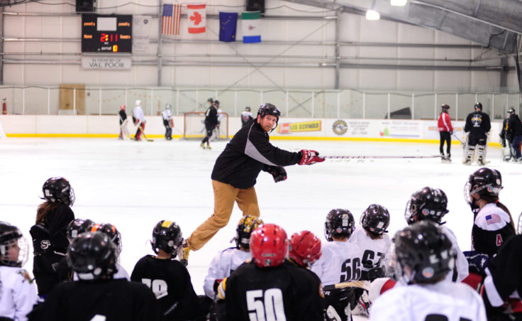 JDIA Coach Matt Boline demonstrates a shot to a group of players attending the association's skills development camp.