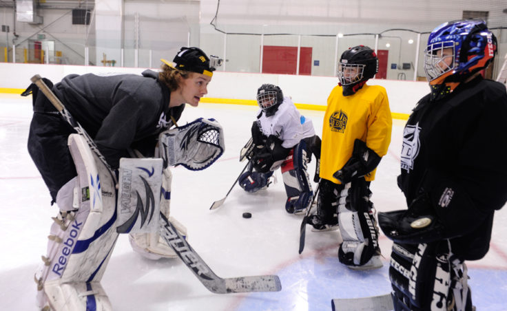 Matt Noreen works with a small group of goalies during JDIA's skills development camp that attracted nine goalies.