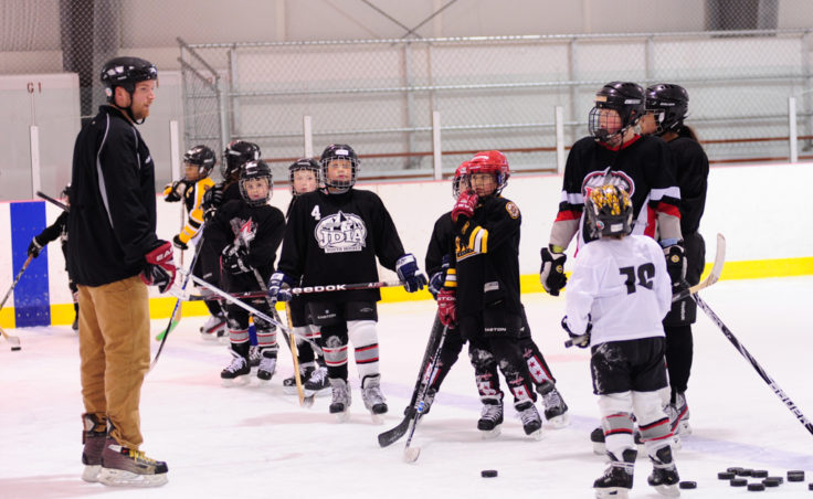 JDIA Coach Matt Boline prepares a group of 25 skaters for their next drill. The camp attracted players ages 5-18.