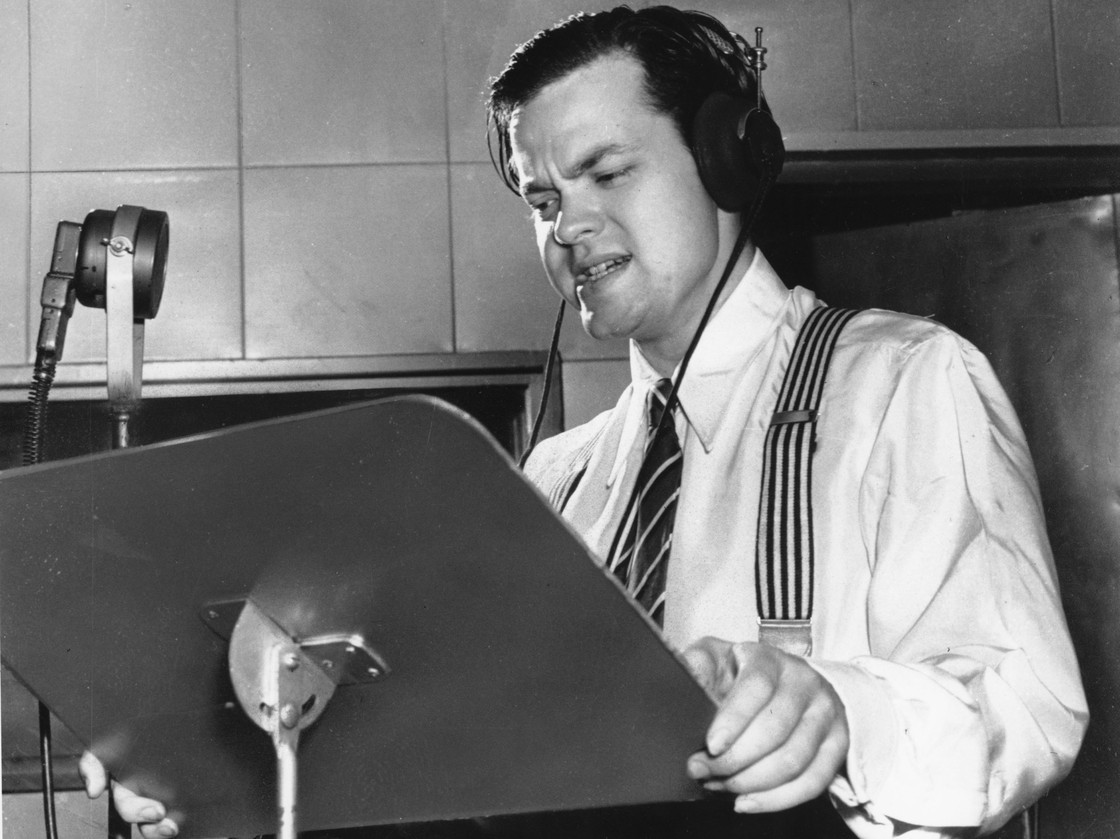 Orson Welles delivering a radio broadcast in 1938, the same year he aired his War of the Worlds fake news program. AP