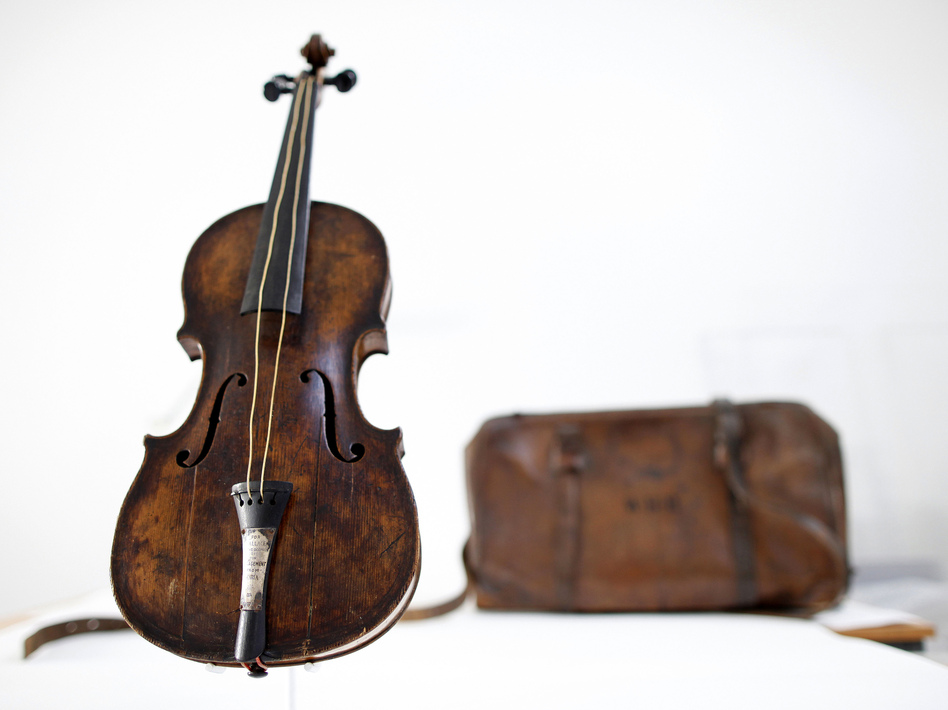 This violin is said to have been played by bandmaster Wallace Hartley during the final moments before the sinking of the Titanic. It's thought he put the instrument in that leather case. Hartley's body and the case were found by a ship that responded to the disaster. Now the violin has been sold.   Peter Muhly /AFP/Getty Images