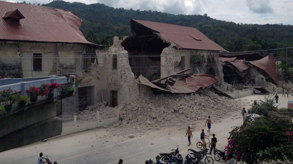 People inspect damage to the Church of San Pedro in the town Loboc, Bohol, after a powerful earthquake struck the region early on Oct. 15, 2013. The earthquake hit near one of the Philippines key tourist hubs, the United States Geological Survey reported. Robert Michael Poole/AFP/Getty Images