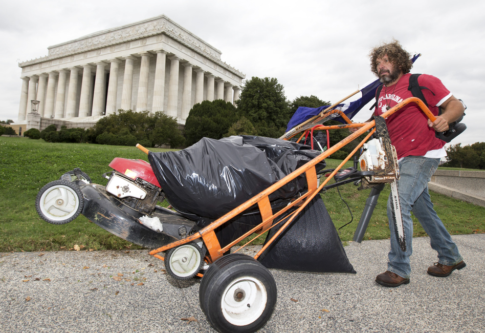 Chris Cox of Mount Pleasant, S.C., pushes a cart near the Lincoln Memorial in Washington, on Wednesday. Manuel Balce Ceneta/AP