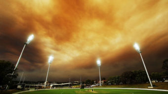 A general view of play as the Sydney skyline is shrouded in smoke during the Ryobi Cup match between the South Australian Redbacks and the Western Australia Warriors at Drummoyne Oval in Australia. Mark Metcalfe/Getty Images