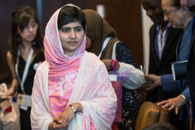 Malala Yousafzai, the 16-year-old Pakistani advocate for girls education who was shot in the head by the Taliban, attends a conversation with the United Nations Secretary General Ban-ki Moon and other youth delegates. Andrew Burton/Getty Images