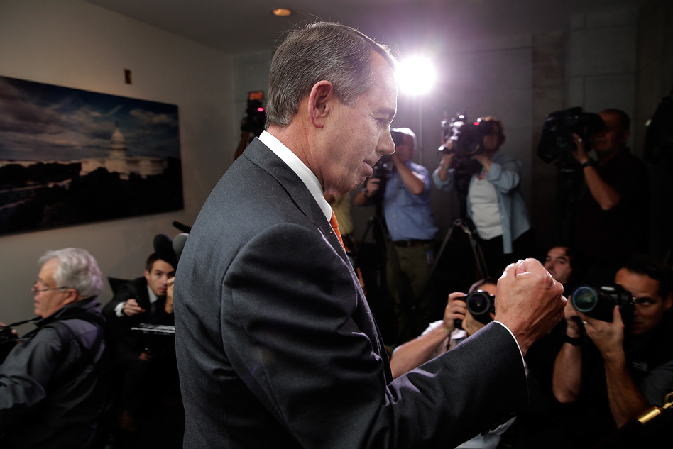 Speaker of the House John Boehner pumps his fist after leaving a meeting of House Republicans at the U.S. Capitol on Wednesday.   Win McNamee/Getty Images