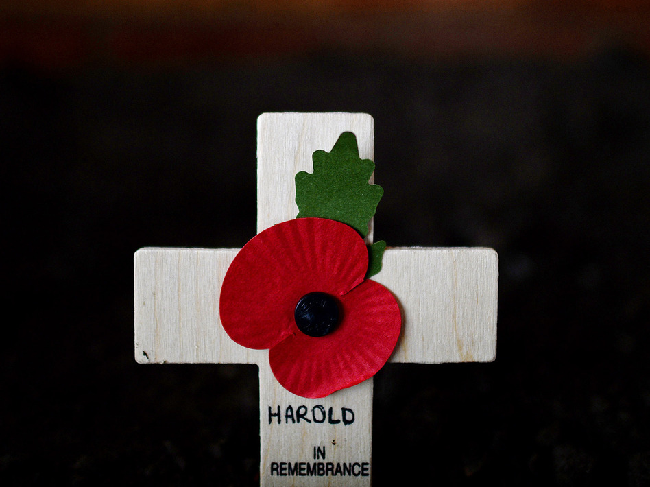 A cross adorned with a poppy was among the ways Harold Percival was remembered Monday. Poppies have been a symbol of remembrance for veterans since the poem In Flanders Fields was written in 1915 by a Canadian military doctor. Nigel Roddis/Getty Images