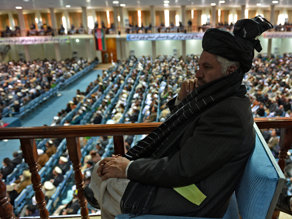A member of the Afghan Loya Jirga listens as the more than 2,000 elders begin debating a proposed U.S.-Afghan security pact on Thursday in Kabul. Massoud Hossaini /AFP/Getty Images