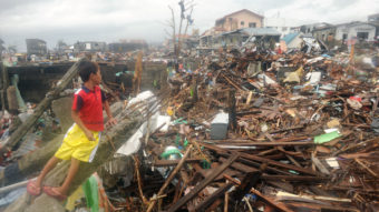 On Tuesday, a boy sat in the debris of destroyed houses in Tacloban, on the eastern Filipino island of Leyte. Noel Celis /AFP/Getty Images