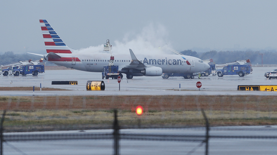 "Cleared for takeoff: That's the message from the ""new"" American Airlines, after a bankruptcy judge ruled it could finalize its merger with US Airways Wednesday. Brandon Wade/AP"