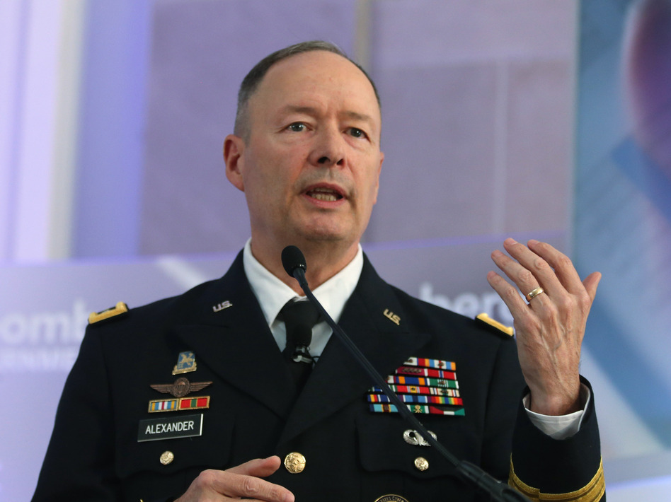 U.S. Army Gen. Keith Alexander, director of the National Security Agency and commander of U.S. Cyber Command, speaks during a conference at the Ronald Reagan Building, in October. Mark Wilson/Getty Images