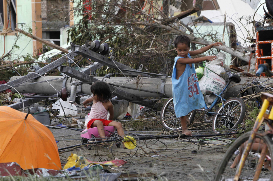 Children play near electric posts which were damaged after super Typhoon Haiyan battered Tacloban city in the central Philippines. Romeo Ranoco /Reuters /Landov