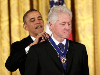 From one president to another: Former President Bill Clinton receives the Presidential Medal of Freedom from current President Obama. Win McNamee/Getty Images