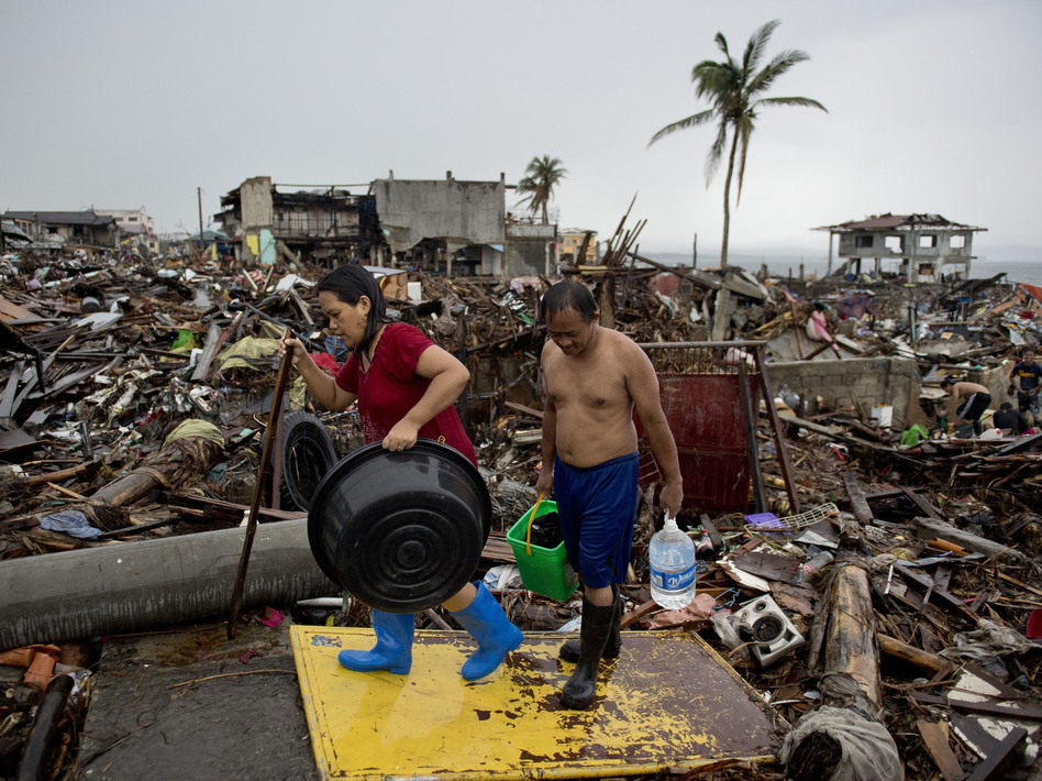 Friday in Tacloban, the Philippines, survivors continued to sift through the rubble. Odd Andersen /AFP/Getty Images