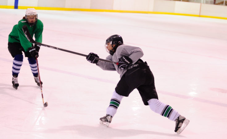 Val Martinez unleashes a shot from just inside the blue line during the 10th Annual Jamboree women's hockey tournament at Treadwell Ice Arena.