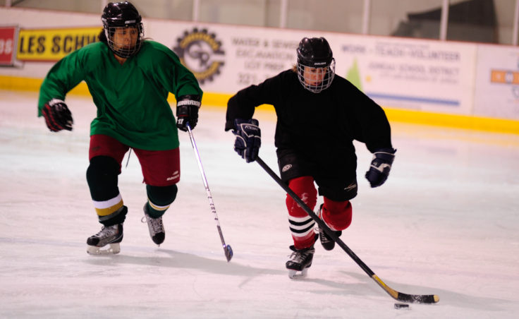 Nandi Than chases down Shelagh More as she breaks up ice during the 10th Annual Jamboree women's hockey tournament at Treadwell Ice Arena.