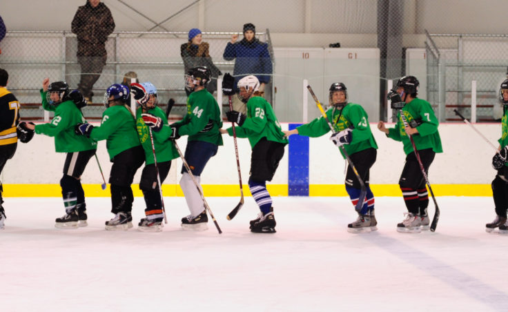Yukon Pass celebrates its women's tier title victory after edging out the Shamrocks, 2-1.