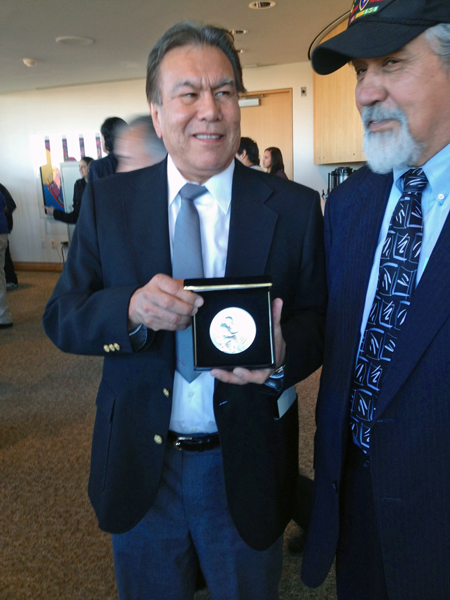 "Robert ""Jeff"" David Jr., left, holds the silver medal awarded to his dad, who the family just learned was a code talker. David, of Haines, traveled to Washington, DC with former legislator Bill Thomas. Photo by Liz Ruskin, APRN – Washington DC."