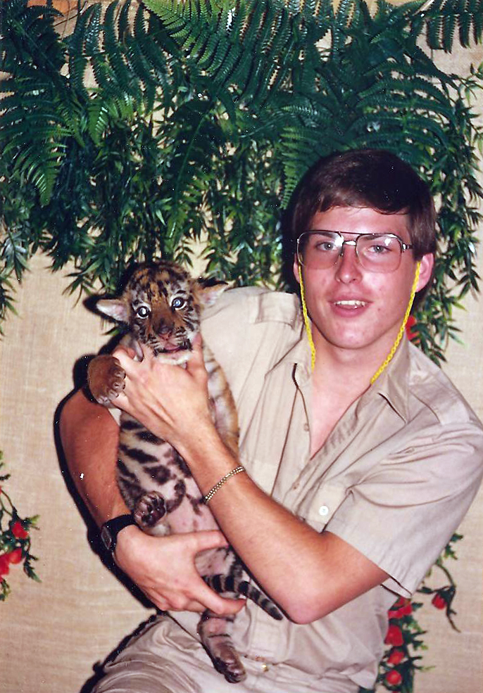 After Aldwyn McCuistion graduated from high school, he traveled throughout the Lower 48 for a few years. One of his favorite jobs was as a trainer for wild cats. Here he is with Tige.