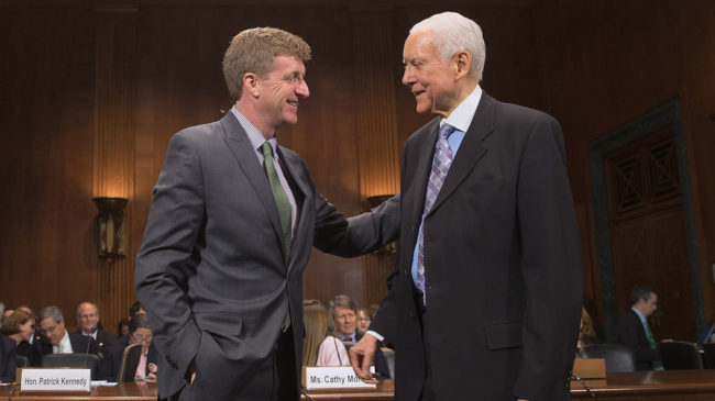 Former Rep. Patrick Kennedy (left) is welcomed by Sen. Orrin Hatch, R-Utah, during a hearing about mental health parity rules Thursday. A new rule issued by the Obama administration aims to increase parity for how insurers handle mental health issues. Chip Somodevilla/Getty Images
