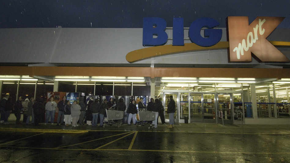 Kmart's plan to be open for 41 straight hours beginning at 6 a.m. Thanksgiving morning is drawing criticism. At this Kmart store in Connecticut, shoppers wait in line to take advantage of sales on Thanksgiving Day. Douglas Healey/AP