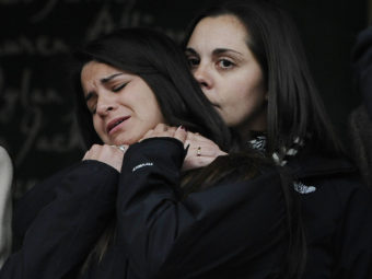 Erica Lafferty (right), daughter of Sandy Hook Elementary School shooting victim Dawn Hochsprung, consoles Carlee Soto, sister of victim Victoria Soto, after representatives of 14 families addressed the media on Monday in Newtown, Conn. Jessica Hill/AP
