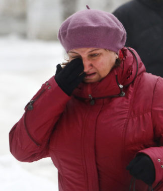 A woman wiped away tears Monday in Volgograd, Russia, after the second suicide bombing in that city in the past two days. Denis Tyrin/AP
