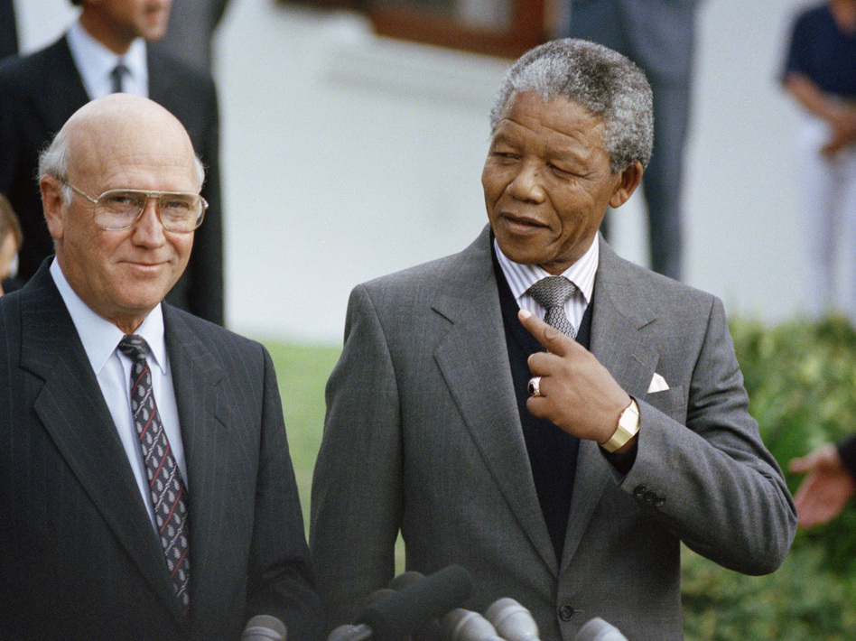 Nelson Mandela with South African President F.W. de Klerk in May 1990. Mandela died Thursday at 95. Denis Farrell/AP