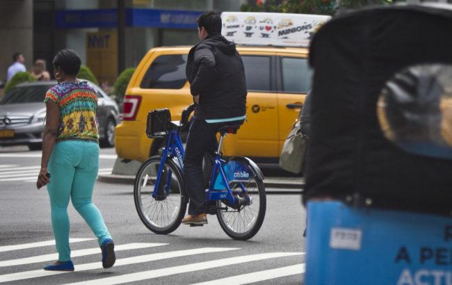 Most bikers don't trust cars. Bebeto Matthews/AP