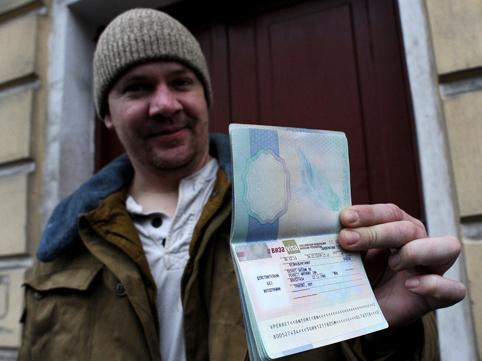 In St. Petersburg on Thursday, Greenpeace International activist Anthony Perrett, a British citizen, showed the Russian transit visa that's now in his passport. (Olga Maltseva/AFP/Getty Images)