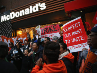Protesters demonstrate at a McDonald's in New York on Dec. 5. Protesters staged events in cities nationwide, demanding a pay raise to $15 per hour for fast-food workers and the right for them to unionize. (John Moore/Getty Images)