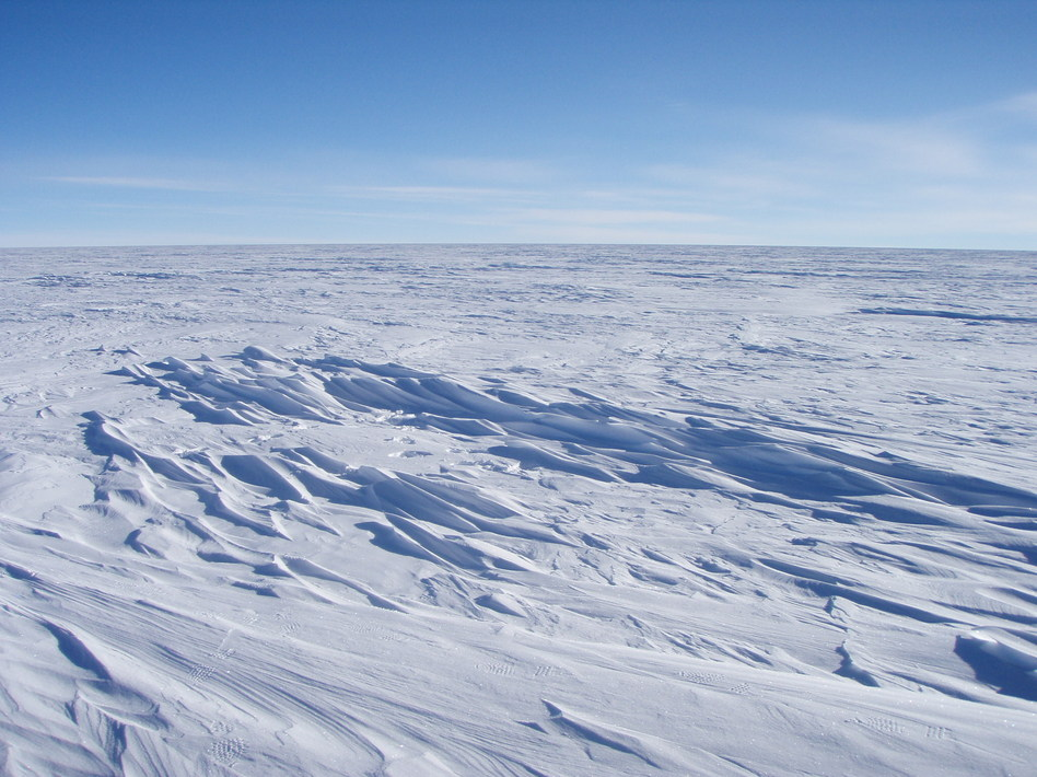 Sastrugi stick out from the snow surface in this photo near Plateau Station in East Antarctica. Most of Antartica looks quite flat, despite the subtle domes, hills, and hollows. Atsuhiro Muto/ National Snow and Ice Data Center