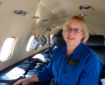 Airlift Northwest's Shelly Deering explains the medical equipment in a medevac Learjet. (Ed Schoenfeld/CoastAlaska)