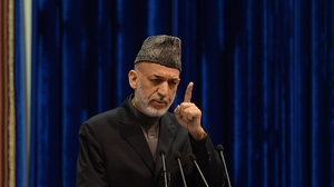 Afghan President Hamid Karzai addresses the Loya Jirga on Sunday. Karzai expressed anger at an airstrike Thursday that killed a child, saying it could imperil a security agreement with the U.S. The U.S.-led international force apologized on Friday for the killing. Massoud Hossaini/AFP/Getty Images