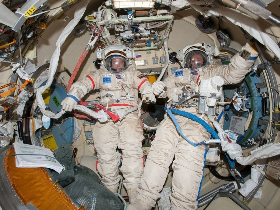 Commander Oleg Kotov (left) and Sergey Ryanzansky, preparing for a spacewalk aboard the ISS on Nov. 9. NASA