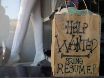 "A ""help wanted"" sign earlier this year in the window of a clothing store in Pasadena, Calif. (Kevork Djansezian/Getty Images)"