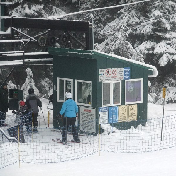 Skiers get on Hooter chairlift Sunday at Eaglecrest.