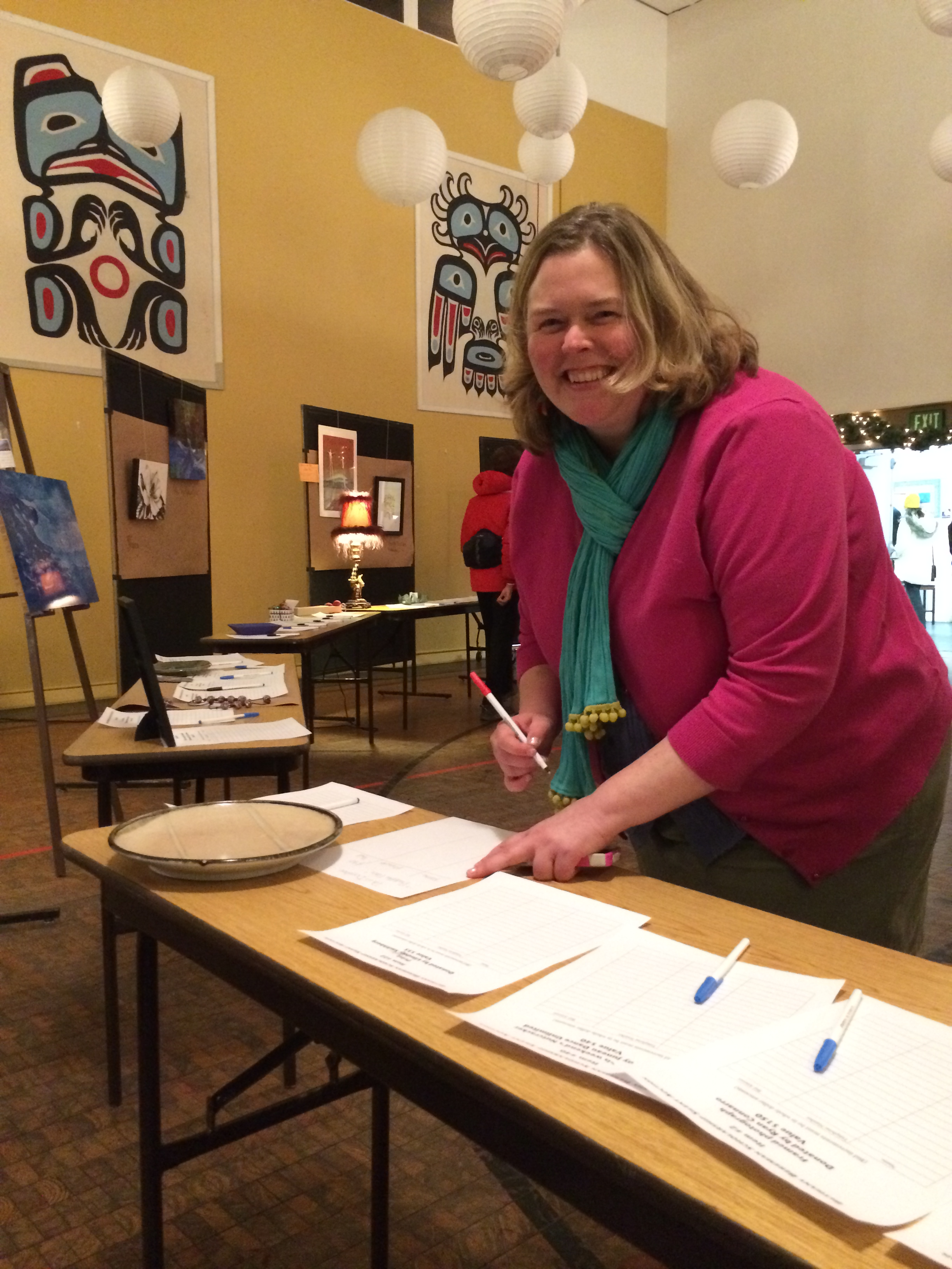 Kristen Garot organizing the silent auction.