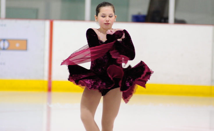 Olivia Gardner performs while Joy to the World plays during Juneau Skating Club's annual holiday recital.