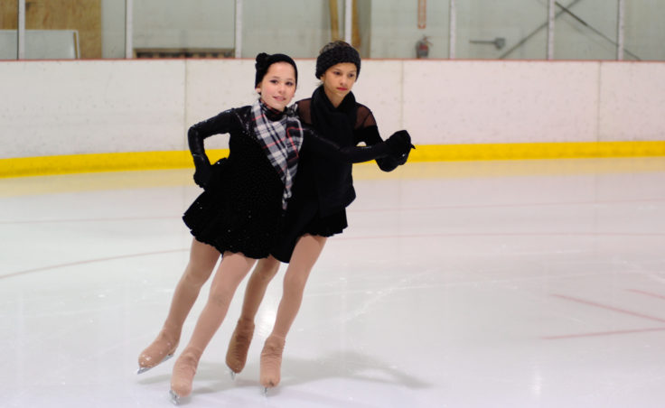 (From Left) Olivia Gardner and Megan Renkes team up during a final group performance skated to It's beginning to look a lot like Christmas.