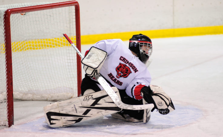Juneau goalie Liam McDermott gets a glove on a North Pole shot during Saturday's game at Treadwell Ice Arena.