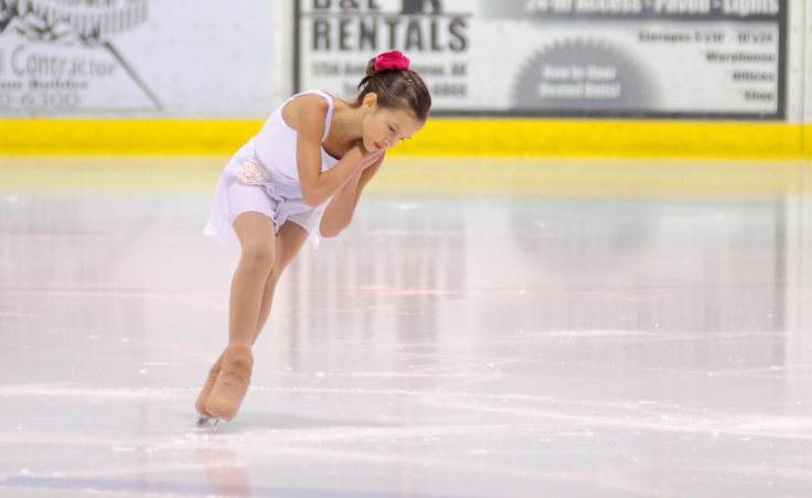 Megan Renkes performs a solo routine to the music Silent Night during Juneau Skating Club's annual holiday recital.