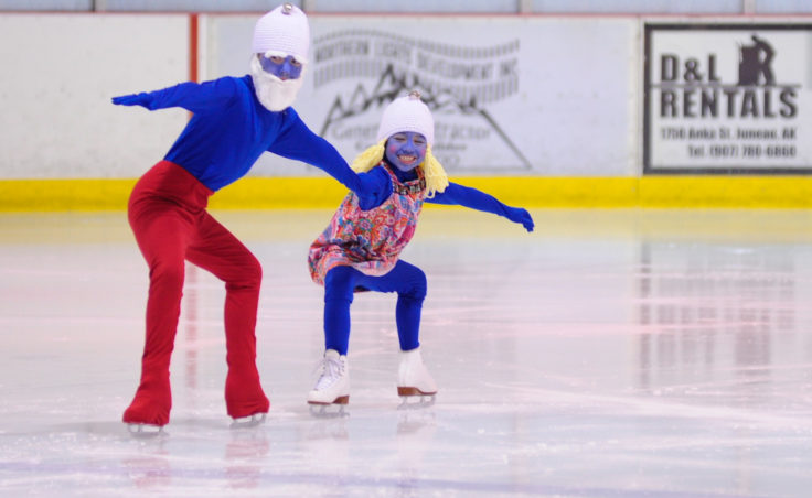 Kara Hort (left) and Ema Jessen bring a little Smurf into the Juneau Skating Club's holiday recital.