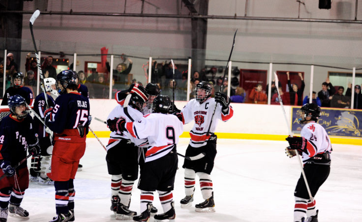 Juneau celebrates Zach Hebert's goal on Friday to keep his team from being shut out in the 4-1 setback to North Pole at Treadwell Ice Arena.