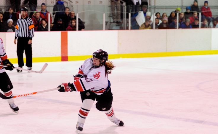 Kathryn Noreen unleashes a shot during a last-minute push in Saturday's 4-2 loss to North Pole at Treadwell Ice Arena.