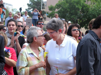 Gail Stockman, 60 (left), and Beth Black, 58, of Albuquerque, N.M., prepare to marry at a massive wedding in August, along with other same-sex couples. Russell Contreras/AP
