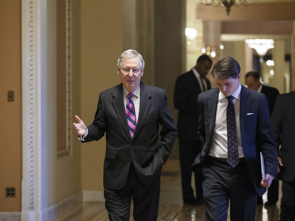 Senate Minority Leader Mitch McConnell (R-Ky.), walks to the chamber for the final votes on the bipartisan budget deal on Wednesday. J. Scott Applewhite/AP