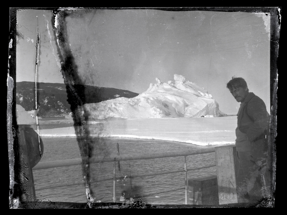 Alexander Stevens, Shackleton's chief scientist, looks south from the deck of the Aurora. Hut Point Peninsula on Ross Island, Antarctica, can be seen in the background. nzaht.org