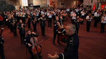 Col. Larry H. Lang conducts the Band's first-ever flash mob at the National Air and Space Museum on Dec. 3. U.S. Air Force