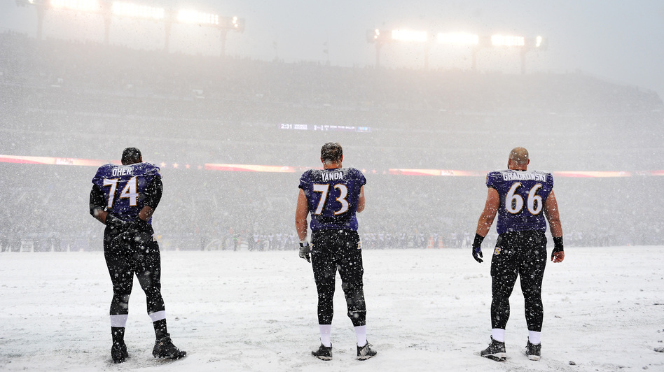A winter storm is hitting an area from Virginia to New England, snarling traffic and closing schools. On Sunday, heavy snowfall changed the look of an NFL game in Baltimore, Md., where Ravens players stood for the national anthem at 1 p.m. Patrick Smith/Getty Images